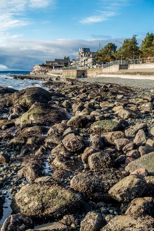 A veiw of the rocky shoreline in West Seattle, Washington.