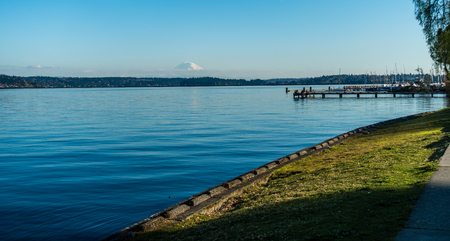 A landscape view of Lake Washington with Mount Rainier in the distance. Stock Photo