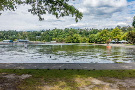 A landscape shot of buildings and an inlet at Gene Coulon Park in Renton, Washington.