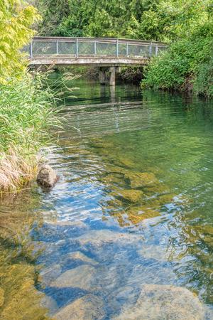 A view of a wooden walking bridge at Getn Coulon Park in Renton, Washington.