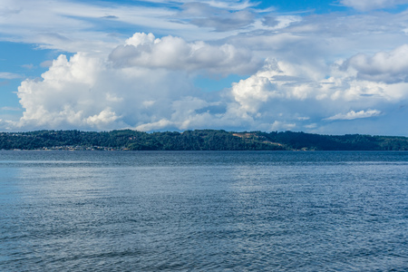 Billowing clouds hover over Maury Island in Washington State.