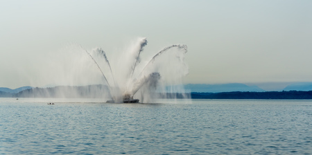 Water blasts out of this fire boat near Seattle, Washington. 版權商用圖片