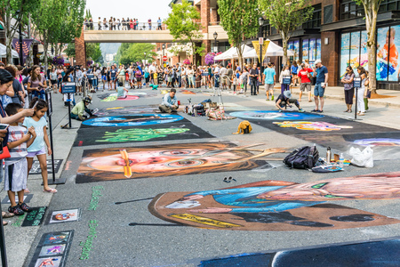 REDMOND, WA.   USA - AUGUST 19TH 2018: Spectators enjoy art at the Chalkfest event in Redmond, Washington.The locations is Redmond Town Center. Editorial