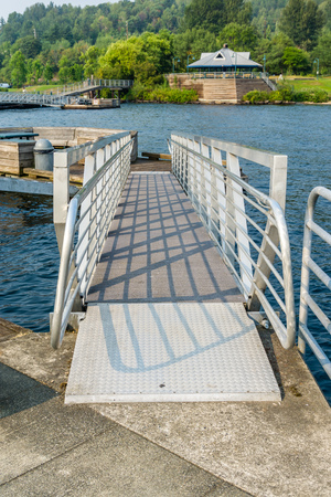 Shadows are cast from dock ramp railings at Gene Coulon Park in Renton, Washington. Фото со стока