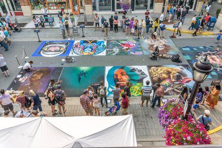 REDMOND, WA. / USA - AUGUST 19TH 2018: Spectators enjoy art at the Chalkfest event in Redmond, Washington.The location is Redmond Town Center. Editorial
