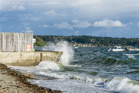 Boats are anchored at Three Tree Point in Burien, Washington on a windy day. Stock Photo