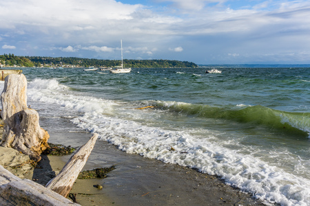 Boats bob on choppy water in the Puget Sound. Location is Normandy Park, Washington.