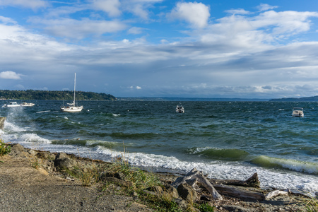 Boats are anchored at Three Tree Point in Burien, Washington on a windy day. Reklamní fotografie