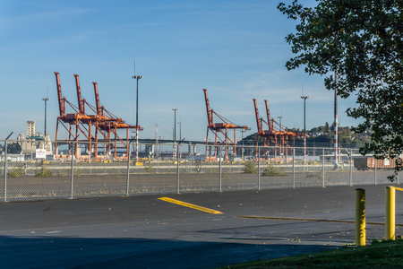 A view of orange cranes at the Port of Seattle. Editorial