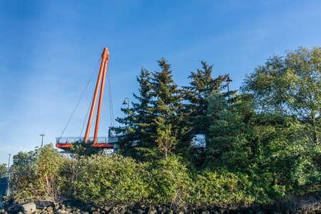 An orange structural arch rises up at the observation deck at Jack Block Park in West , Washington.