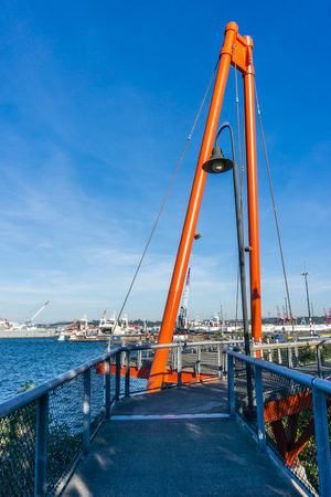 An orange structural arch rises up at the observation deck at Jack Block Park in West Seattle, Washington.