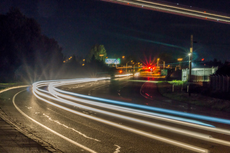 An abstract shot of moving car lights at a slow shutter speed. Redactioneel