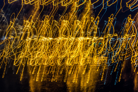 Lights at the Des Moines Marina make abstract waves. Shot taken at slow shutter speed with a flip of the wrist. Reklamní fotografie