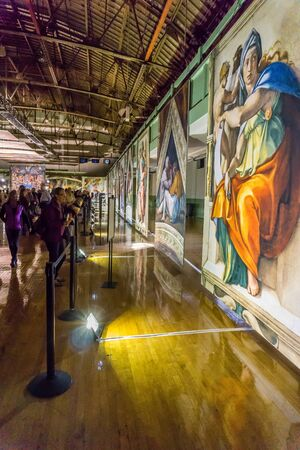 Tacoma, WA, USA - October 11, 2018        Art lovers appreciate the hangings at the Michaelangelo Sistine Chapel art exhiibit. Location is the Tacoma Armory.