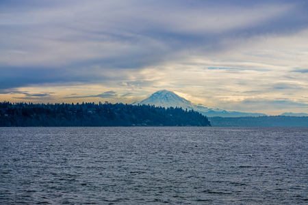 Clouds hover over Mount Rainier. Stock Photo
