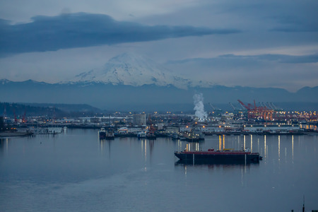 A view of the Port of Tacoma at night. Stock Photo