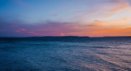 A view of an ethereal sunset sky from West Seattle, Washington. Фото со стока