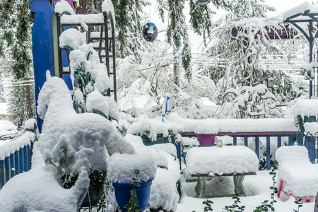 A front porch is buried in snow in Burien, Washington.