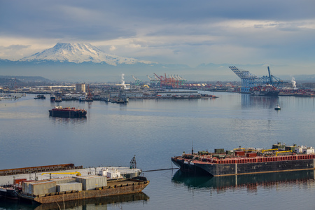 A view of the Port of Tacoma with Mount Rainier above.