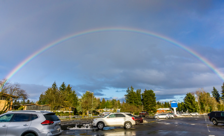 A rainbow arcs over Burien, Washington.