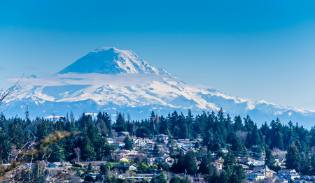 A view of Mount Rainier and homes.