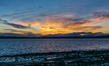 The last of the sunset is on display as darkness falls over the Puget Sound.