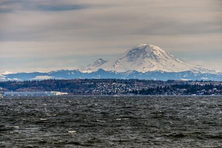 A view of Mount Rainier across Lake Washington. Stock Photo