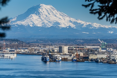 A view of the Port of Tacoma and Mount Rainier. Stock Photo