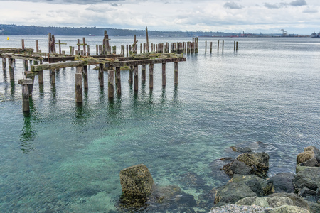 A view of decaying pilings along the shore in Ruston, Washington near Tacoma. Stock Photo