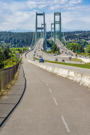 Two suspension bridges known as the Narrows Bridge in Tacoma, Washington.