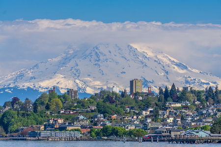 Mount Rainers seems to be right on top of a neighborhood in Tacoma, Washington.