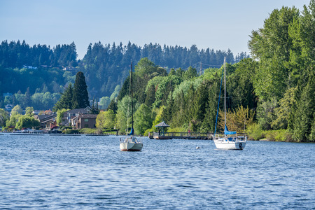 A view of the shoreline at Gene Coulon Park with boat anchored in front.