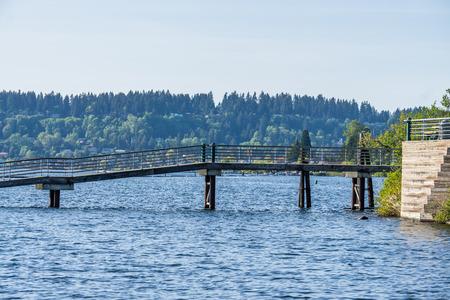 A pier spans water at Gene Coulon Park in Renton, Washington.