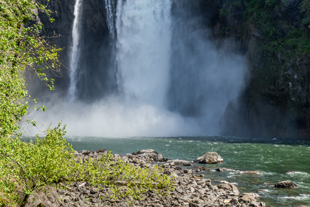 Water explodes at the bottom of Snoqualime Falls in Washington State. Imagens