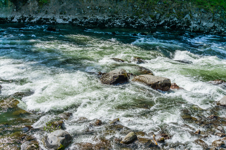 A view of the white rapids on the Snoqualmie River in Washington. State. Stock fotó