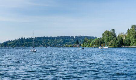 Sailboats are anchored on Lake Washington in Renton, Washington. 写真素材