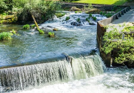 Water flows over a ledge in Tumwater, Washington. Stock Photo
