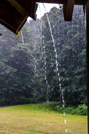 Raindrops stream off of a roof in Renton, Washington. Stock fotó