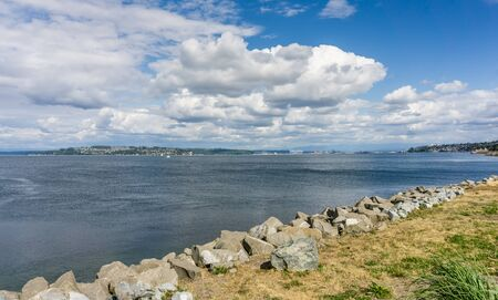 A view of the shoreline at Dune Peninsula Park with the Port of Tacoma in the distance.