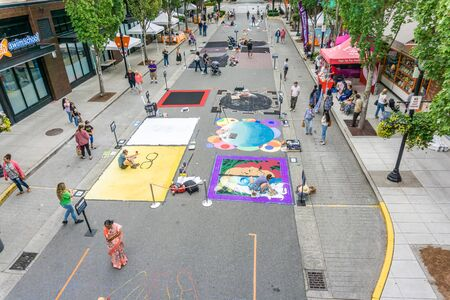 REDMOND WA., USA  -AUGUST 16,  2019: The firsft day of Chalkfest event. A view of people enjoying the art and artists.