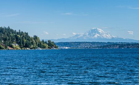 A landscape shot with Lake Washington and Mount Rainier in the distance.