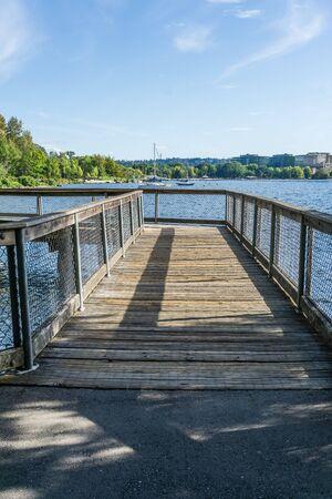 A wooden walking bridge at Gene Coulon Park in Renton, Washington. Фото со стока