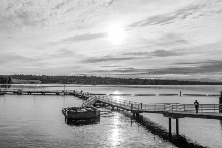 A view of the pier at Gene Coulon Park in Renton, Washington on a cloudy day. Фото со стока