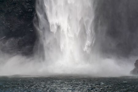 Spray and whitewater at the bottom of Snoqualmie Falls in Washington State. Stock fotó