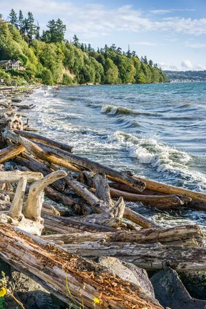 Whitewater flys up as wave hit shore on the Puget Sound. Stock fotó