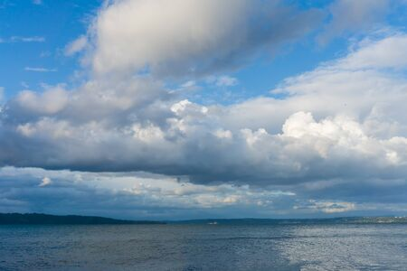 Billowing clouds hang over the Puget Sound in Washington State. Stock fotó
