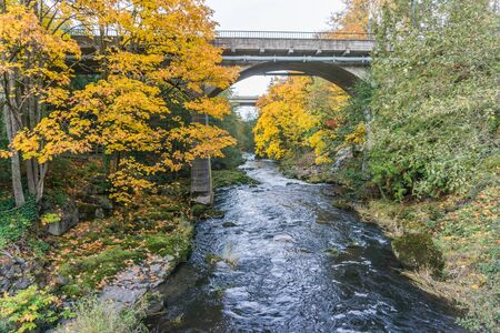 A bridge is above the river at Tumwater Falls Park in Washington State.