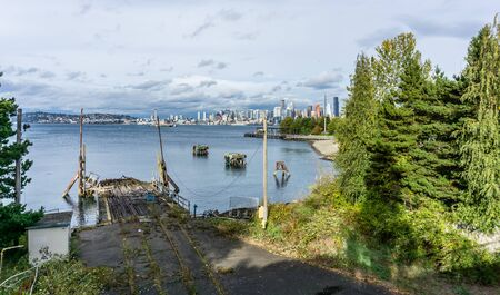 A view of a derelict wharf and the Seattle skyline.