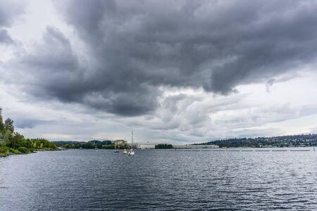 Storm clouds hang over Gene Coulon Park in Renton, Washington. Фото со стока