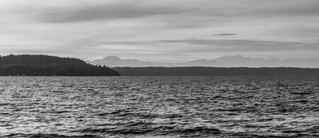 A view of the Puget Sound and mountains covered with haze. 写真素材